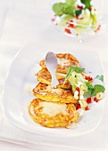 Cheese and sweetcorn cakes with cucumber salad