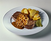 Beefsteak with potatoes and onion sauce