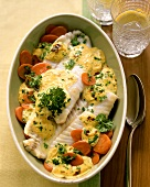 Baked coley on carrots with mustard