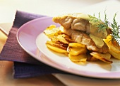 Fish fillet with mustard and dill sauce and fried potatoes