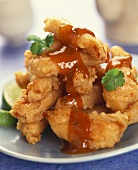 Chicken pieces in batter with spicy sauce