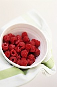 Fresh raspberries in small bowl
