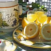 Limoncello and lemons on plate in Italian restaurant