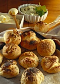 Freshly baked rolls with poppy seeds, sesame & caraway; butter