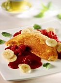 Soufflé omelette with raspberries and bananas