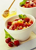 Melon and cherry salad with honey