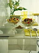 Pasta salad and rice salad on laid table