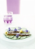 Herring with cucumber and borage flowers