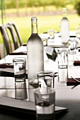 Laid table with water bottles and glasses
