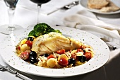 Cod fillet with olives, cherry tomatoes and broccoli