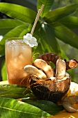 Tamarinds in hollowed-out coconut; tamarind cocktail