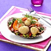 Scallops with garlic on vegetable salad