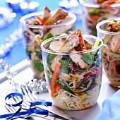 Pasta salad with vegetables and chicken in glasses