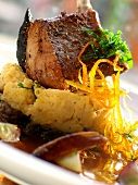 Lamb chop on mashed potato with chick-peas