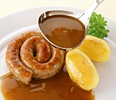 Fried sausage ring with potatoes and gravy