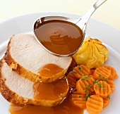 Roast pork with gravy, carrots and duchess potatoes