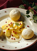 Yeasted rolls with vanilla sauce and stewed apples