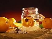 Home-made orange liqueur with sugar crystals
