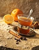 Tea punch with orange and cinnamon