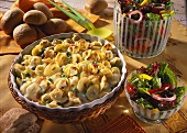 Baked tortellini with peas and bacon; salad