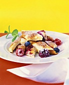 Berry pancakes (Schmarrn) with icing sugar