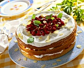 Wild strawberry cake with cream and flaked almonds