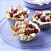 Cherry tarts on cake rack