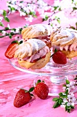 Cream puffs with strawberry cream on cake plate
