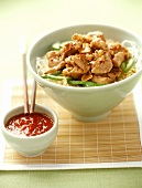 Chicken with lemon grass on rice noodles; chili sauce