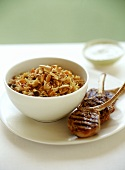 Lamb cutlets with spicy raisin rice