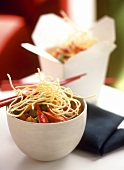 Chicken ragout with vegetables and crispy noodles