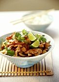 Turkey ragout with coriander leaves and lime