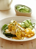 Chicken breast with curry sauce, mango and cucumber salad