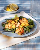 Green salad with shrimps and mango