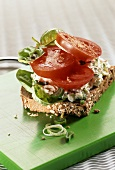 Wholemeal bread with soft cheese, basil and tomatoes