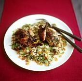 Quails on raisin couscous