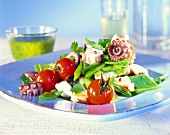 Octopus salad with cherry tomatoes and mangetouts