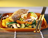 Chicken breast with peanuts and vegetables, cooked in the wok