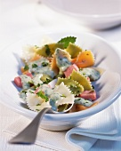 Farfalle with herb cream and ham