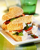 Sesame bagel with soft cheese and tomatoes