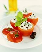 Tomatoes stuffed with olive cheese