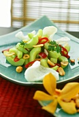 Cucumber salad with peanuts and prawn crackers