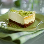 Piece of cheesecake with lime