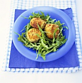 Rocket salad with breaded aubergine slices