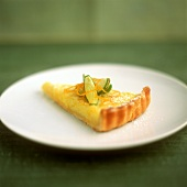 Piece of lime tart on plate