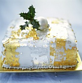 Christmas cake with edible gold and silver leaf decorations