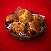 Blackberry muffin, raisin and brioches in bread basket