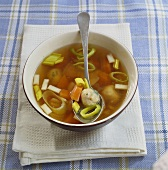 Chicken soup with matzeknaidlach (bread dumplings, Jewish)
