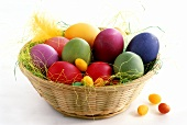 Coloured Easter eggs in basket