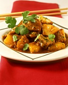 Sweet and sour pork ragout with pineapple